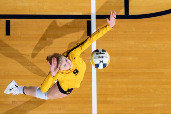 Volleyball senior MacKenzi Welsh serves