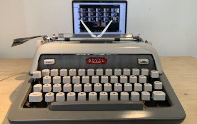 Typewriter with Zoom screen behind it